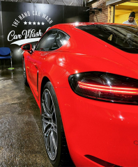 Red Porsche Cayman in for a Gold Club Hand Car Wash